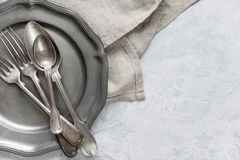 Silverware on a pewter plate Stock Photos