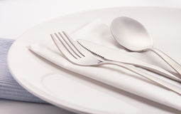 Silverware on plate Stock Photo