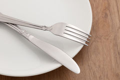 Silverware on plate Stock Photography