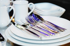 Silverware on plates Stock Images