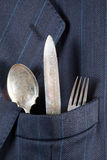 Silverware in a pocket Stock Image