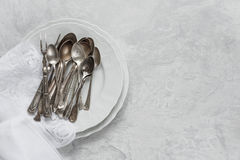 Silverware on a porcelain plates Royalty Free Stock Images