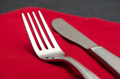 Silverware  on red napkin Stock Images