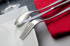 Silverware  on red napkin Stock Photos