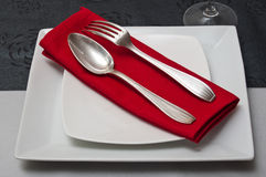 Silverware  on red napkin Royalty Free Stock Photo