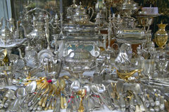 Silverware and silver items for sale at Flea Market, Paris, France Royalty Free Stock Photo