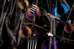 Silverware and soap Stock Images