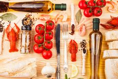 Silverware with spices, cherry tomatoes and cancers. Big set from silverware, different spices, boiled cancers, cherry tomatoes, greenery and olive oil bottles royalty free stock photos