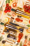 Silverware with spices, cherry tomatoes and cancers. Set from silverware, different spices, boiled cancers, cherry tomatoes, greenery and olive oil bottles on stock images