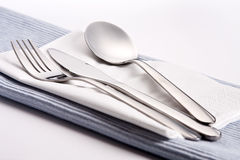 Silverware on tablecloth Stock Photos