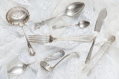 Silverware on a white lace Royalty Free Stock Images