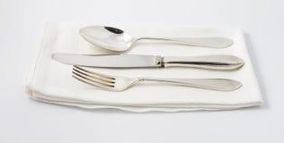 Silverware on white napkin Stock Images