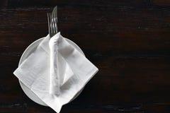 Silverware in white napkin Royalty Free Stock Photography