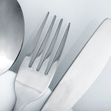 Silverware  on white table Royalty Free Stock Image