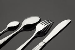 Silverware on white table Royalty Free Stock Images