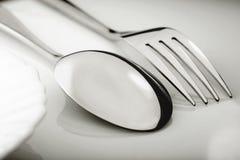 Silverware on white table Stock Photos