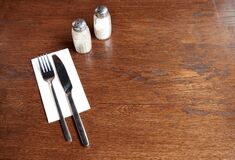 Free Silverware With Salt And Pepper On A Rustic Pub Table Stock Image - 169579651