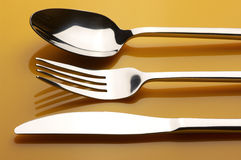 Silverware on yellow Stock Image