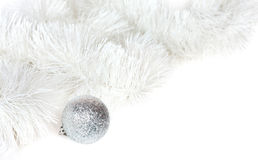 Silvery ball and Christmas tinsel Stock Photo