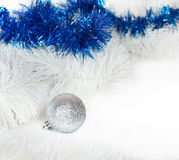 Silvery ball and Christmas tinsel Royalty Free Stock Photography