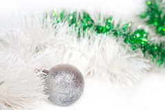Silvery ball with Christmas tinsel Stock Image