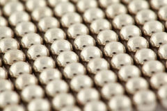 Silvery beads are interlaced together Stock Photos