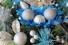 Silvery Christmas balls and blue tinsel on a Christmas wreath Stock Photo