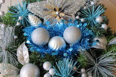 Silvery Christmas balls and blue tinsel on a Christmas wreath Royalty Free Stock Photo