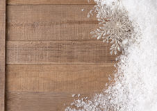 Silvery Christmas Snowflake Ornament in Snowbank on Rustic Wood background with Room or Space for Copy, Text, Words.  Horizontal Stock Photography