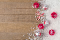 Silvery Christmas Snowflake Ornament in Snowbank on Rustic Wood background with Room or Space for Copy, Text, or your Words Stock Images