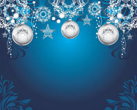 Silvery Christmas toys on dark blue decorative background Stock Photography