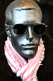 Silvery display dummy. With sunglasses stock photography