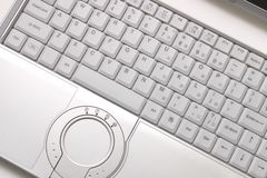 Silvery hi-end laptop. Keyboard of silvery hi-end modern laptop with round touchpad Stock Images