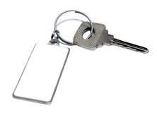 Silvery key with a charm a frame Royalty Free Stock Image