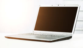 Silvery laptop at modern office Stock Photos