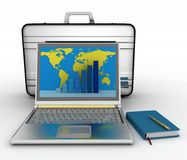 Silvery laptop, notepad and pen with black brief-case Royalty Free Stock Photo