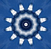 Silvery metal objects  seen through kaleidoscope. Digital art design. Abstract silvery  texture of metal against blue sky  seen through a kaleidoscope. It looks