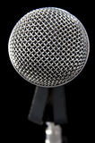 Silvery microphone on black. Silver shiny microphone on black stock photos