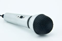 A silvery microphone on the white background Royalty Free Stock Photography