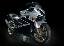 Silvery  motorcycle. Silvery sports motorcycle against dark background Royalty Free Stock Photography
