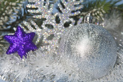 Silvery New Year ball and decorative snowflake, small depth of sharpness Royalty Free Stock Photo