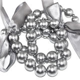 Silvery pearl necklace. With bows Stock Photos