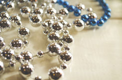 Silvery and shiny beads as background. For holiday decorations Stock Photography