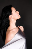 Silvery silk and naked body woman Stock Photo