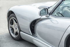 Silvery sports car on road Stock Image
