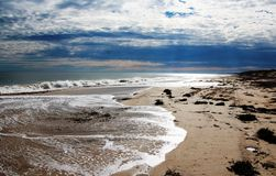 Silvery Surf on Stormy Day Stock Image