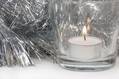 Silvery Tinsel and Candle royalty free stock image