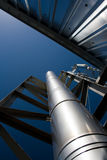 Silvery wall, chimney, aerials and sky. Silvery wall, chimney, metal construction and aerials against deep blue sky Royalty Free Stock Photos