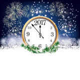Silvester Clock 2017 Fireworks. Silvester card with snowflakes, fireworks and clock with date 2017 on the dark background Stock Photo