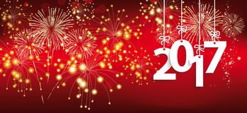 Silvester Hanging 2017 Header Fireworks. Red silvester card with hanging red numbers 2017 and fireworks Royalty Free Stock Image